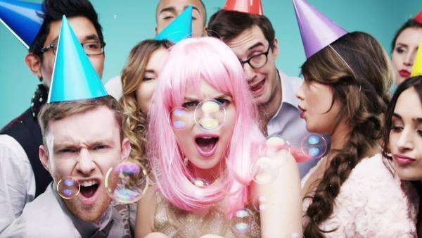 Group of happy people dancing with bubbles slow motion party photo booth Royalty-free stock video