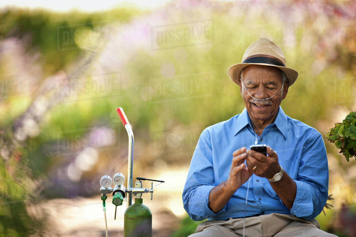 Senior man looking at the cellphone and laughing. Royalty-free stock photo