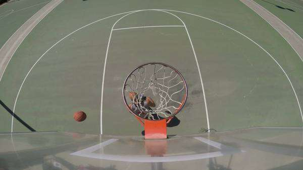 Overhead angle of two people playing basketball outside Royalty-free stock video