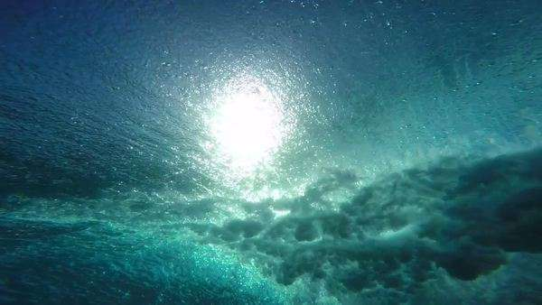 Slow motion underwater angle of wave crashing from behind Royalty-free stock video