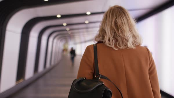 Woman walks through a colorful subway tunnel, in slow motion  Royalty-free stock video