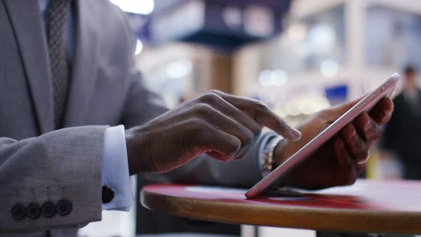 Business professional using a tablet as he is out and about Royalty-free stock video