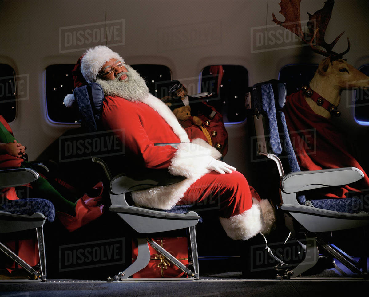Santa Clause, reindeer and presents on an airplane Royalty-free stock photo