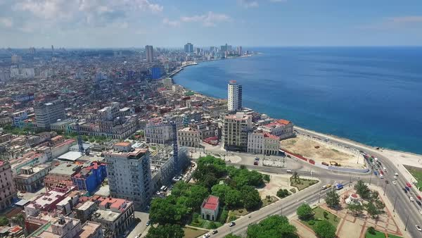 Drone flying over Old Havana, Cuba: Malecon promenade, Caribbean sea, Habana Vieja district Royalty-free stock video
