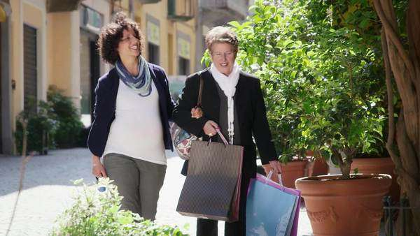 Senior woman and pregnant woman shopping amicably Royalty-free stock video