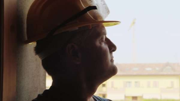 Professional people at work, portrait of happy and confident architect, engineer, manual worker with safety helmet in construction site, looking at new building Royalty-free stock video