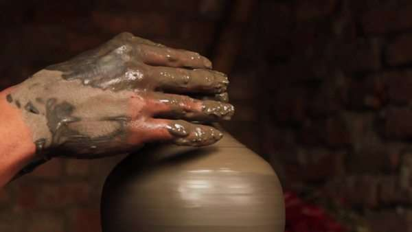 Close up shot of an expert potter moulding a traditional clay pot. Royalty-free stock video