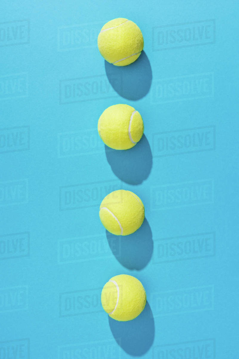 Top View Of Arranged Tennis Balls On Blue Background Stock Photo Dissolve