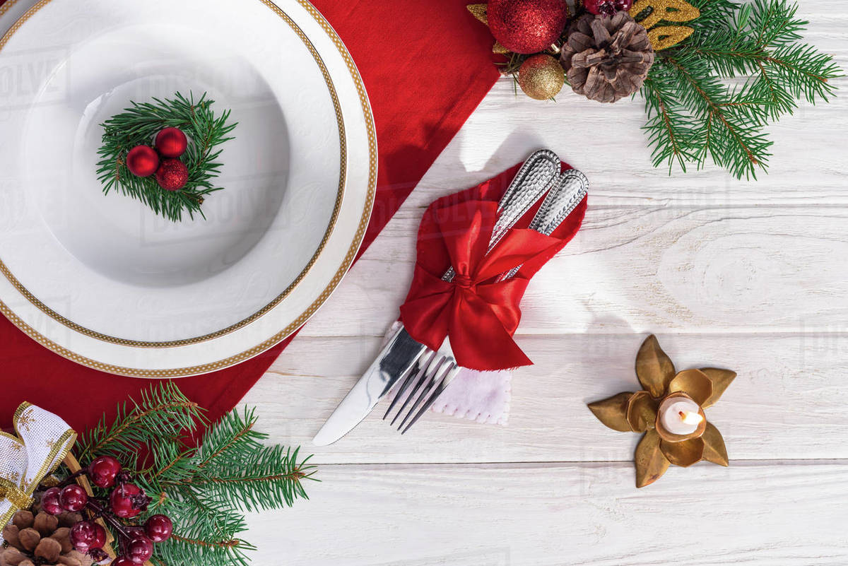 Christmas Top View.Top View Of Served Table With Candle Fork And Knife Plate And Christmas Decorations On Wooden Table Stock Photo