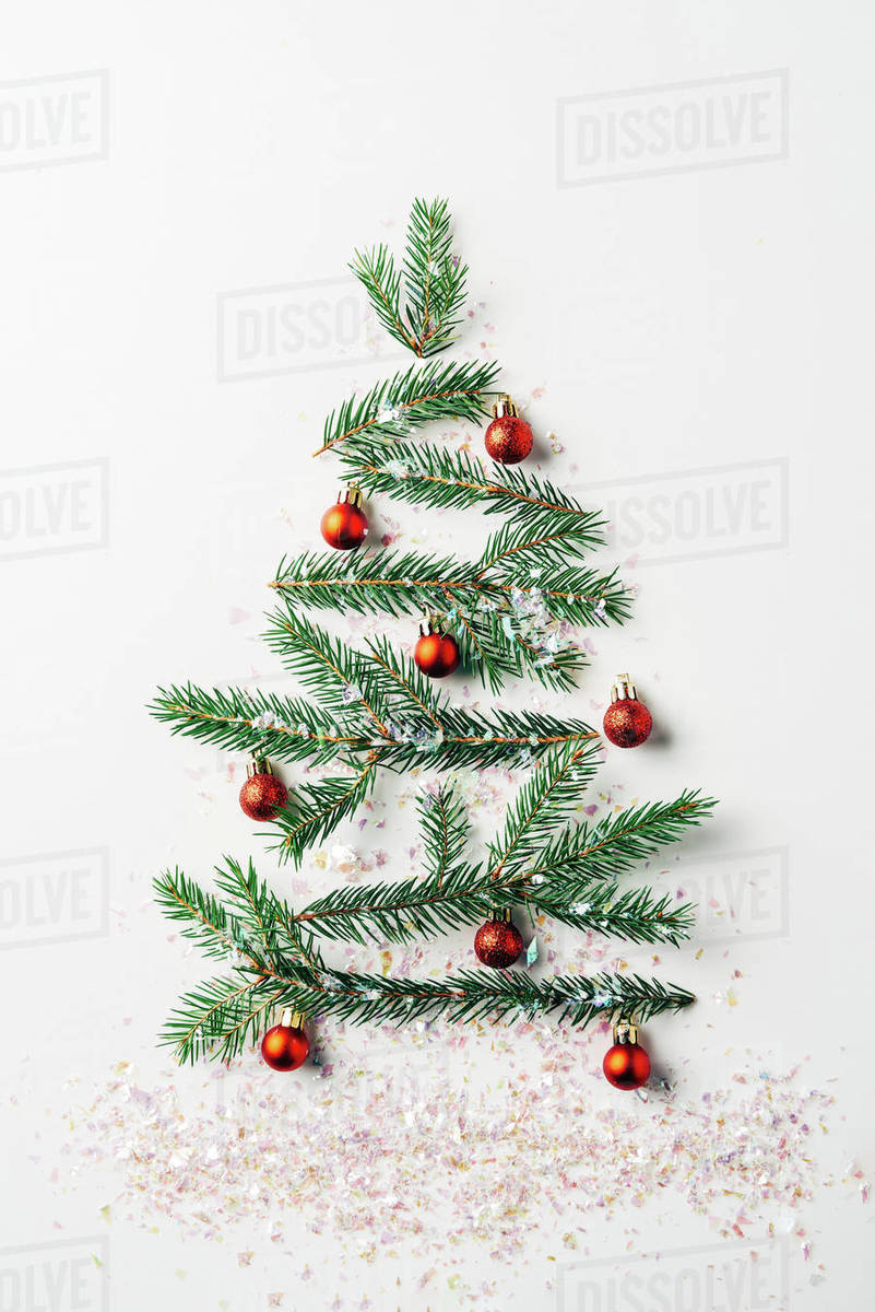Christmas Tree Top View.Top View Of Green Pine Branch Decorated As Festive Christmas Tree With Glitters On White Background Stock Photo