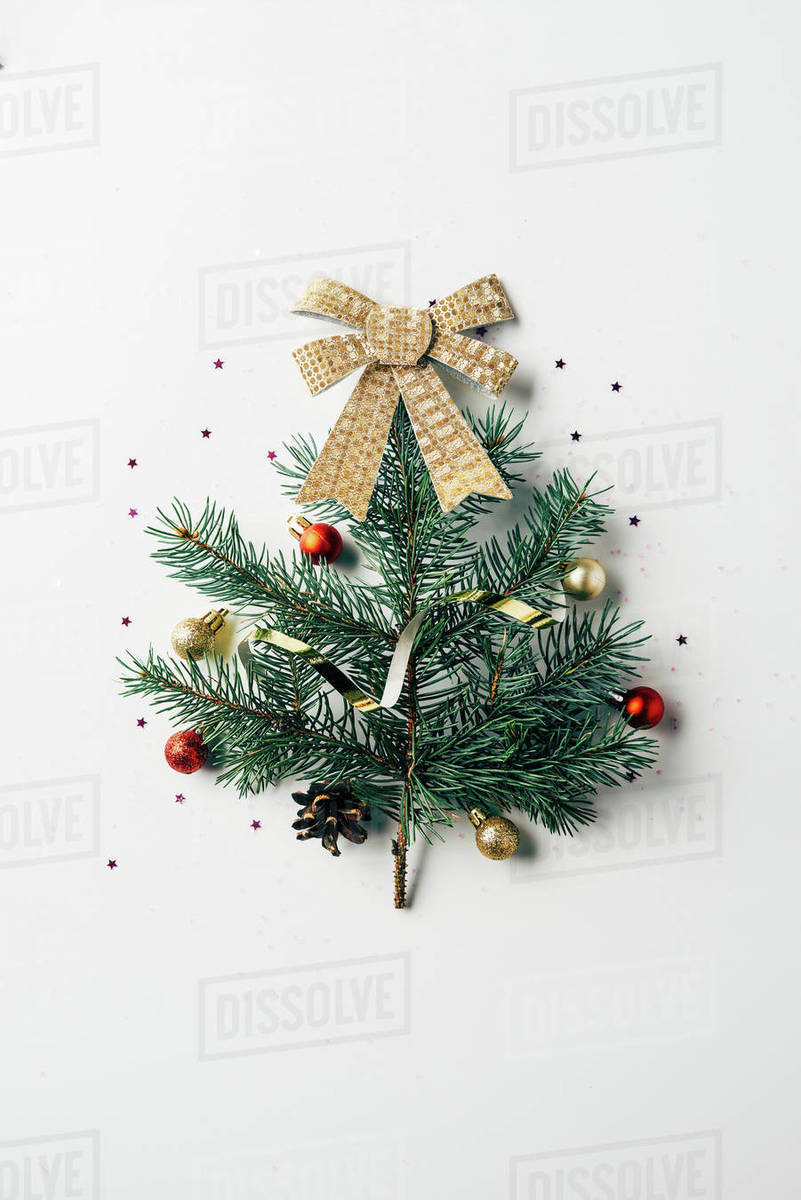 Christmas Tree Top View.Top View Of Green Pine Branch Decorated As Festive Christmas Tree With Bow On White Background Stock Photo