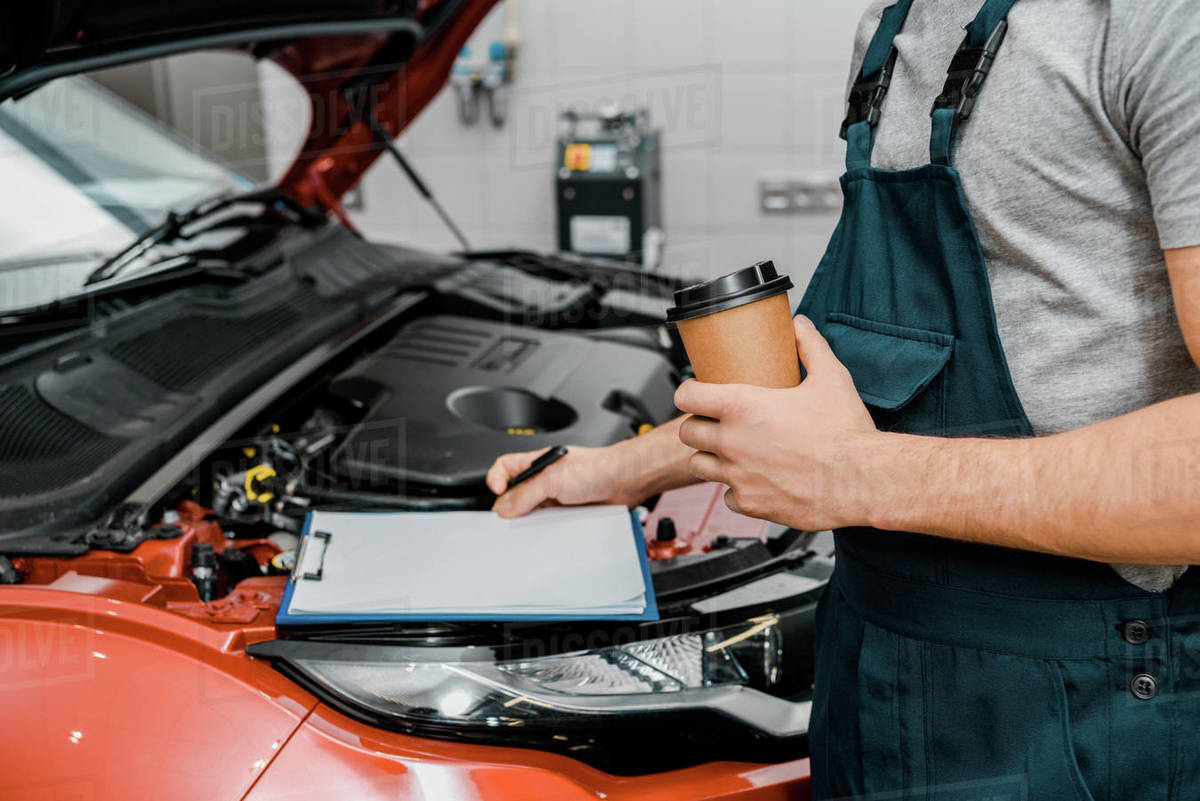 Auto Repair Nearby >> Partial View Of Male Auto Mechanic With Notepad And Coffee D2115 183 216