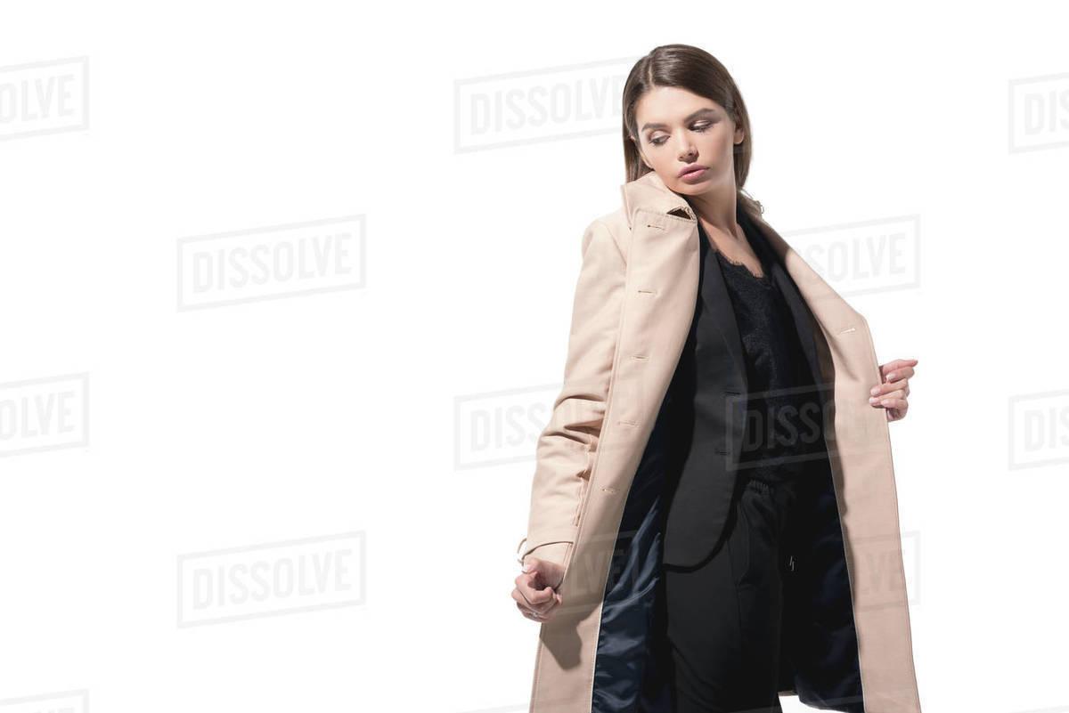 big sale 54395 e9aee stylish elegant woman posing in trench coat, isolated on white stock photo