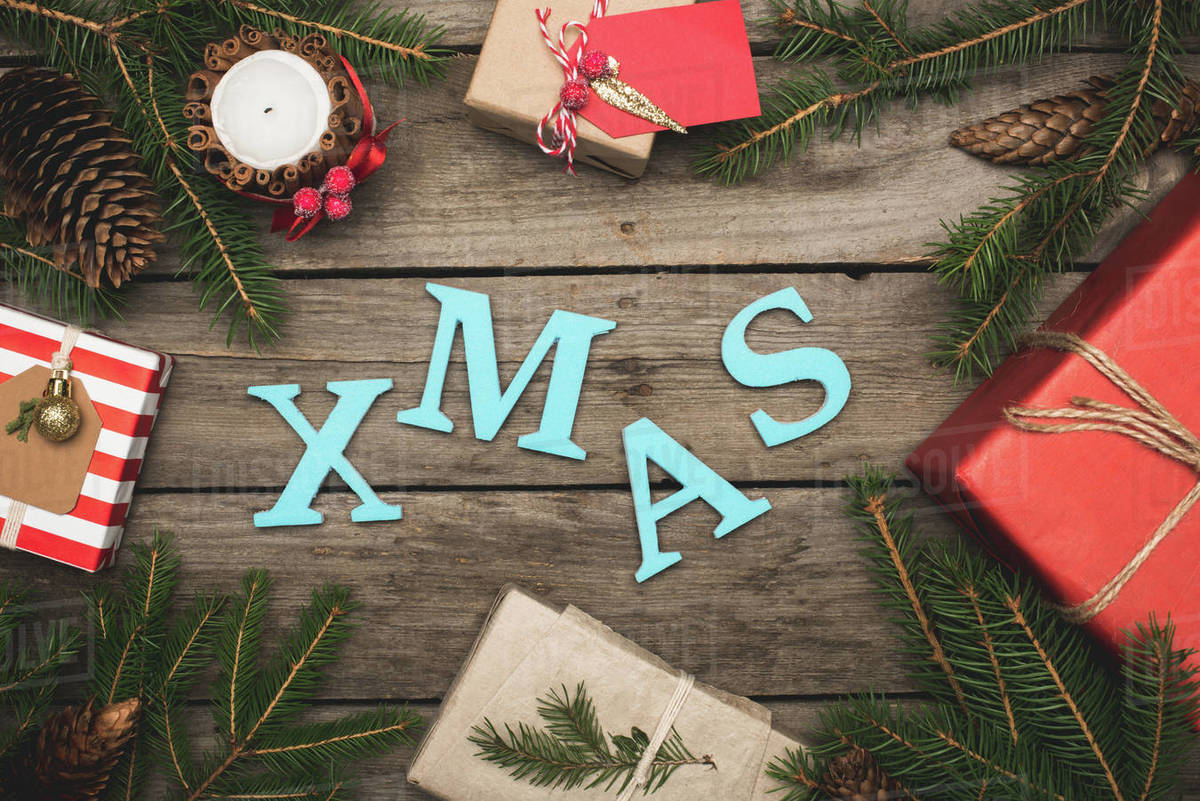 Christmas Top View.Top View Of Composition Of Christmas Gifts And Branches With Xmas Sign Stock Photo