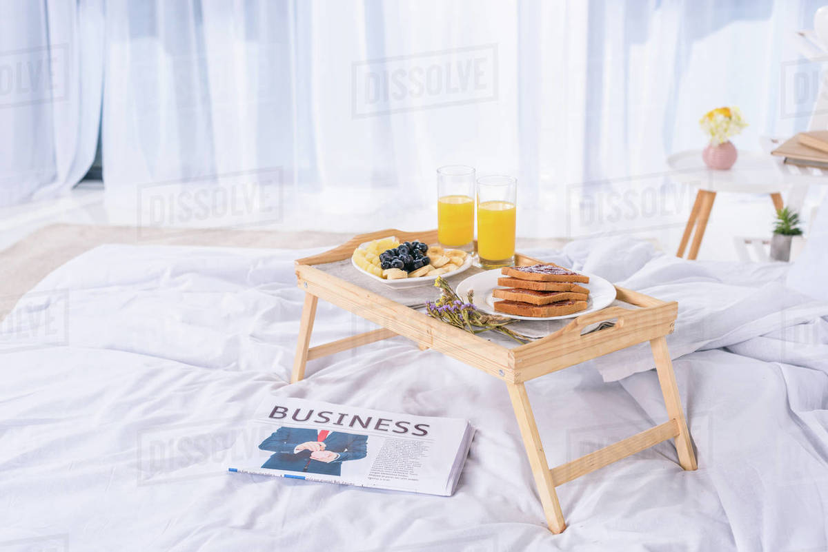 Healthy Breakfast In Bed On Wooden Tray At Morning Stock Photo Dissolve