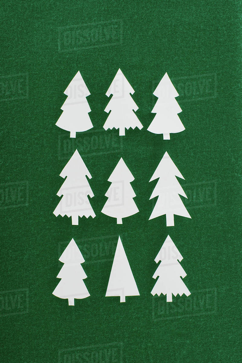 Christmas Tree Top View.Top View Of Decorative Paper Christmas Trees On Green Background Stock Photo