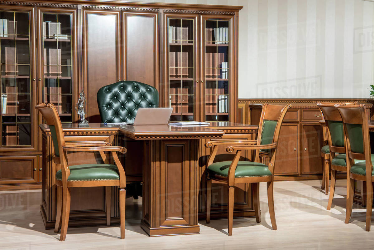 Picture of: Interior Of Office Room With Chairs And Laptop On Wooden Table In Classic Design Stock Photo Dissolve