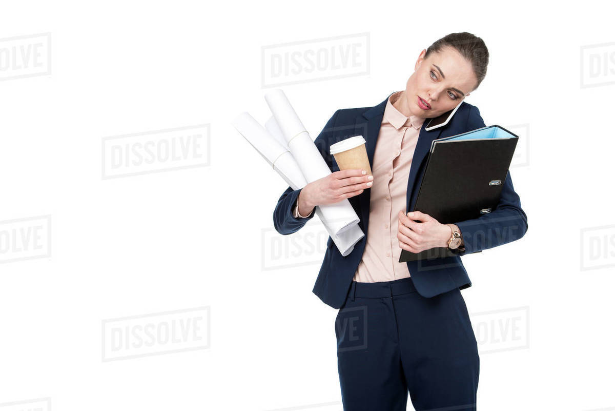 Adult Businesswoman With Lot Of Paperwork And Coffee To Go Talking By Phone Isolated On White Stock Photo