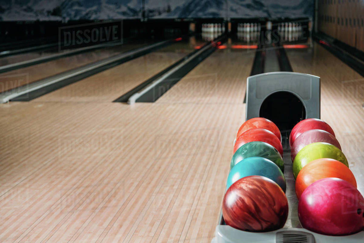 Stand With Colorful Bowling Balls In Club In Front Of Alleys Stock Photo Dissolve