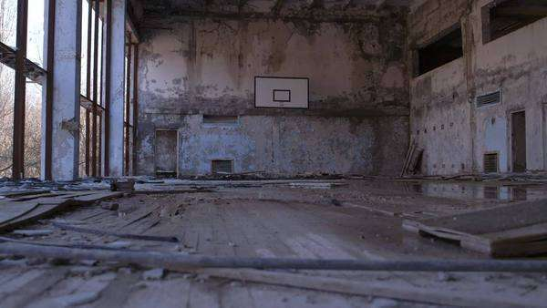 Tracking shot of abandoned basketball court Rights-managed stock video