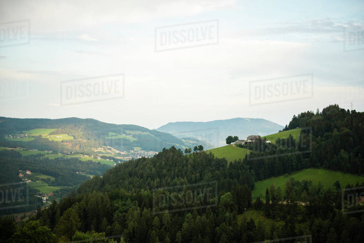 Lonely farmhouse standing on the hill amidst trees Royalty-free stock photo