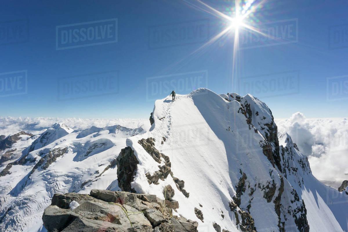 Man reaching the Top of Piz Bernina mountain, Swiss Alps, Graubunden, Switzerland Royalty-free stock photo