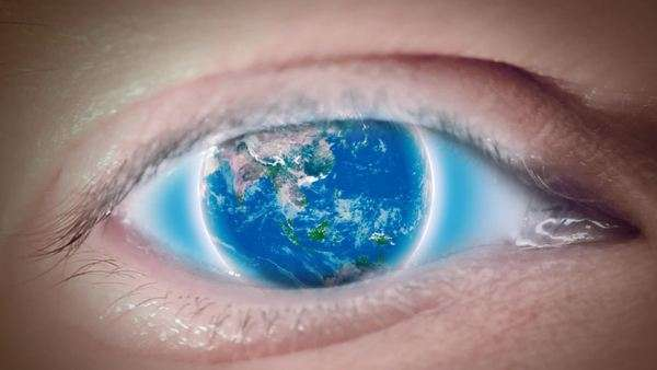 Close up to eyeball with rotating Earth instead iris, loop Royalty-free stock video