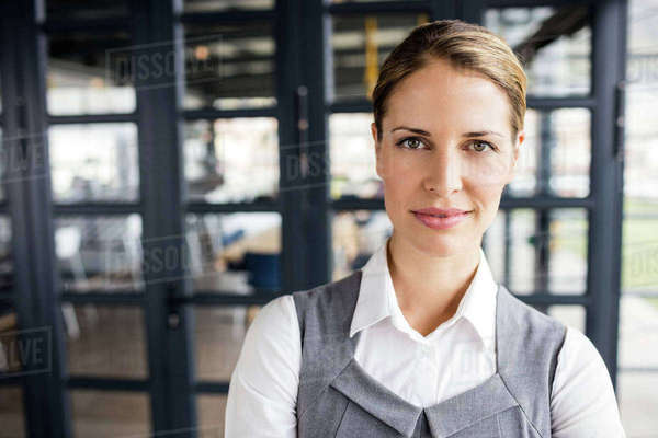 Portrait of a smiling businesswoman in office Royalty-free stock photo