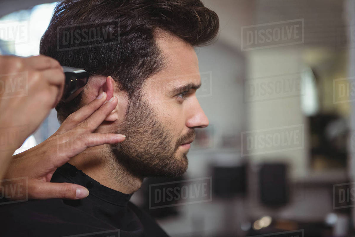 Amazing Man Getting His Hair Trimmed At The Hair Salon Stock Photo Natural Hairstyles Runnerswayorg