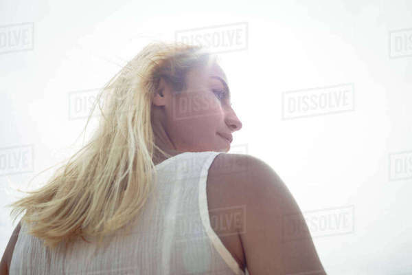 Rear view of a carefree blonde woman on a sunny day Royalty-free stock photo