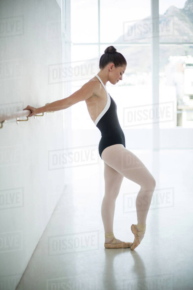 Ballerina practicing ballet dance in the studio stock photo