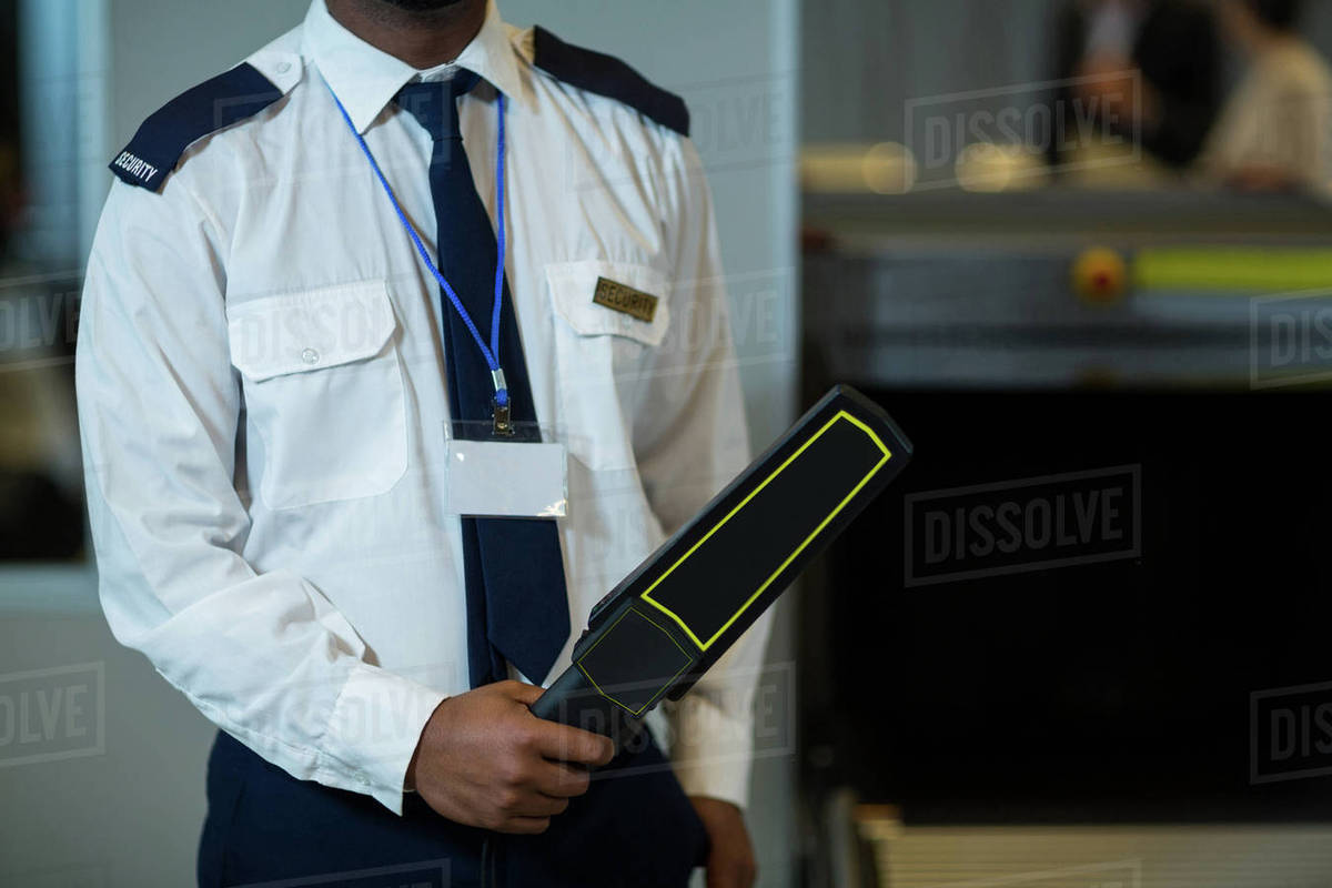 Jew Detector: Mid Section Of Airport Security Officer Holding Metal