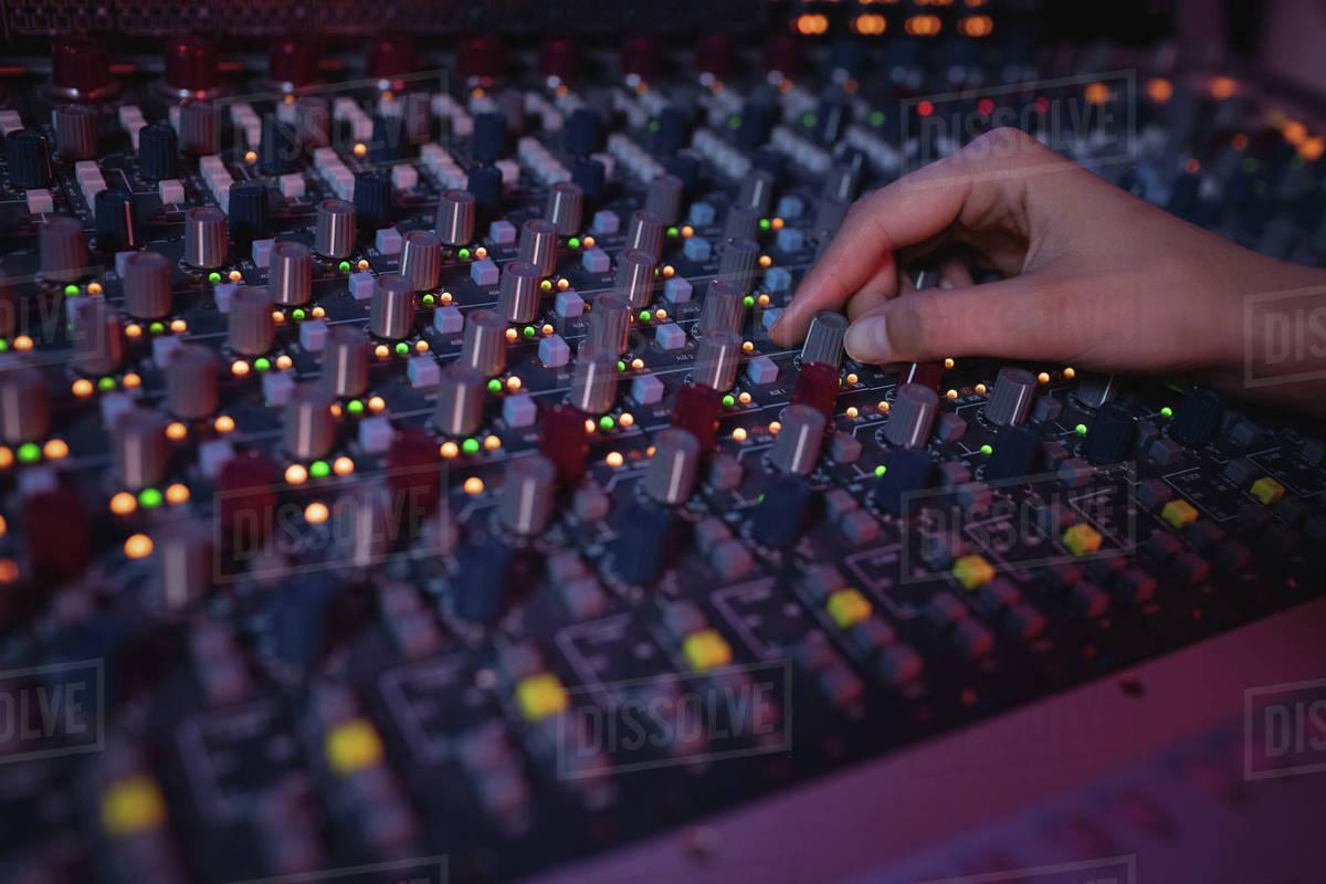 Hands of female audio engineer using sound mixer in recording studio stock  photo