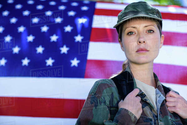 Portrait of soldier standing in front of american flag  Royalty-free stock photo