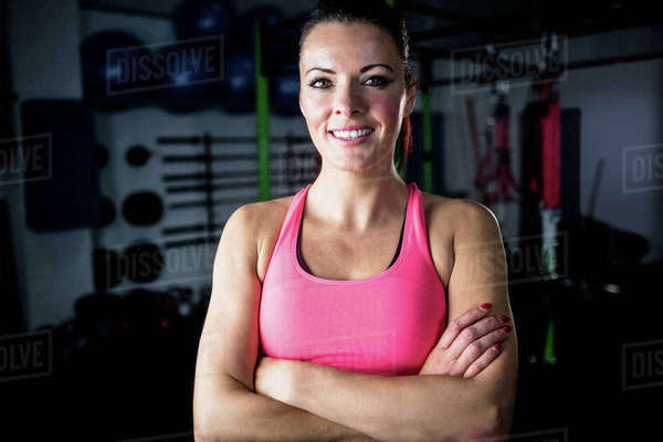 Portrait of woman standing with arms crossed at gym Royalty-free stock photo