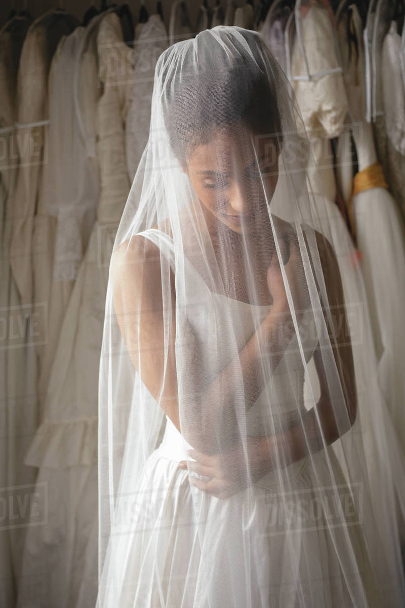 Young bride in wedding dress at boutique - Stock Photo - Dissolve