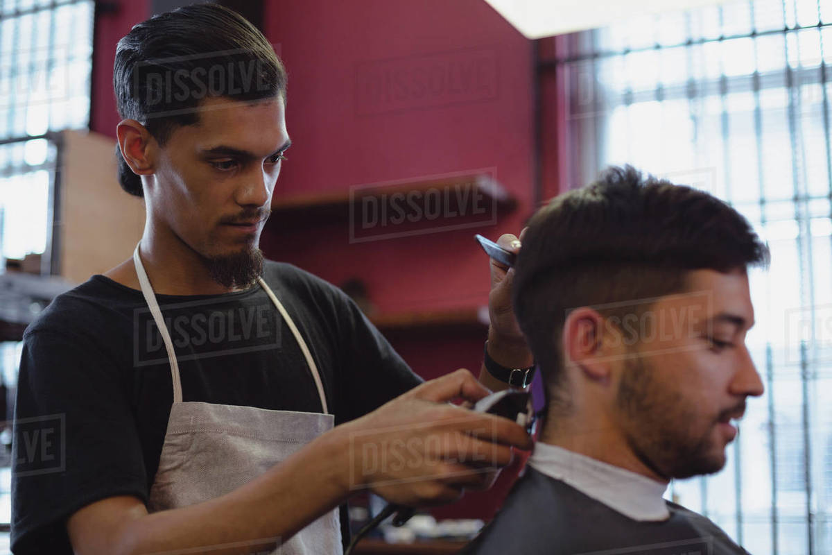 Excellent Man Getting His Hair Trimmed With Trimmer At Barbershop Stock Natural Hairstyles Runnerswayorg