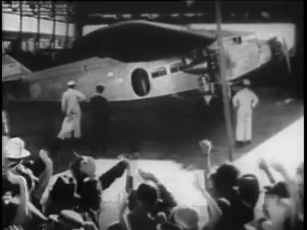 Panning shot of people waving at vintage aircraft during take off, 1930s Royalty-free stock video
