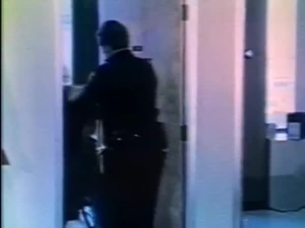 Rear view of police officers walking with man in handcuffs towards interview room Royalty-free stock video