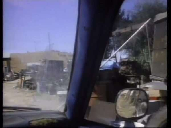 View out of car window driving through junkyard Royalty-free stock video