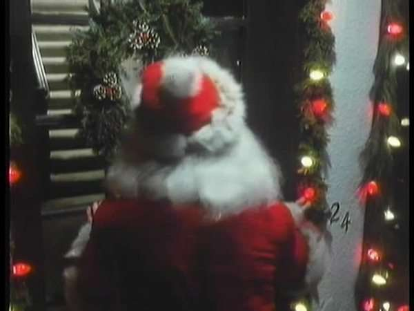 Santa Claus ringing door bell Royalty-free stock video