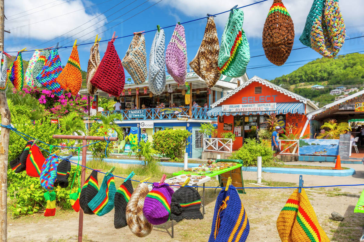 Colourful shops in Port Elizabeth, Admiralty Bay, Bequia, The Grenadines, St. Vincent and the Grenadines, Windward Islands, West Indies, Caribbean, Central America Royalty-free stock photo