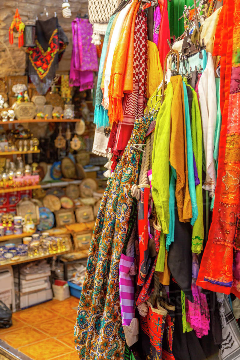 Colourful garments, Souk Khan al-Zeit Street in Old City, Old City, UNESCO World Heritage Site, Jerusalem, Israel, Middle East Royalty-free stock photo