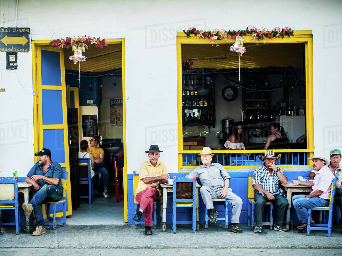 Men sit outside a bar, Jardin, Antioquia, Colombia, South America Royalty-free stock photo
