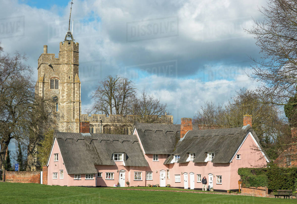 The village green in Cavendish with the medieval St. Mary church tower and traditional pink thatched cottages, Cavendish, Suffolk, England, United Kingdom, Europe Royalty-free stock photo