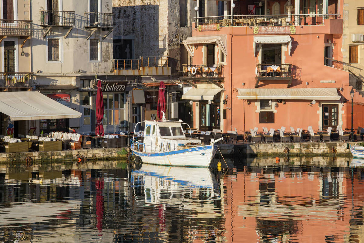 Colourful reflections in the Venetian Harbour, early morning, Rethymno (Rethymnon), Crete, Greek Islands, Greece, Europe Royalty-free stock photo