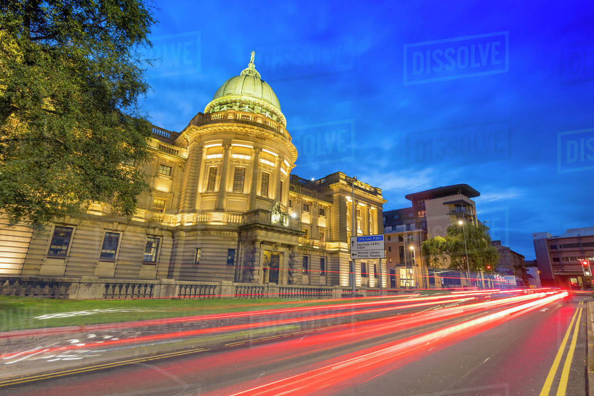 Mitchell Library with traffic trail lights at dusk, Glasgow, Scotland, United Kingdom, Europe Royalty-free stock photo