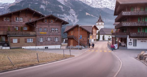 Traffic and Church in Grindelwald village, Jungfrau region, Bernese Oberland, Swiss Alps, Switzerland, Europe Royalty-free stock video