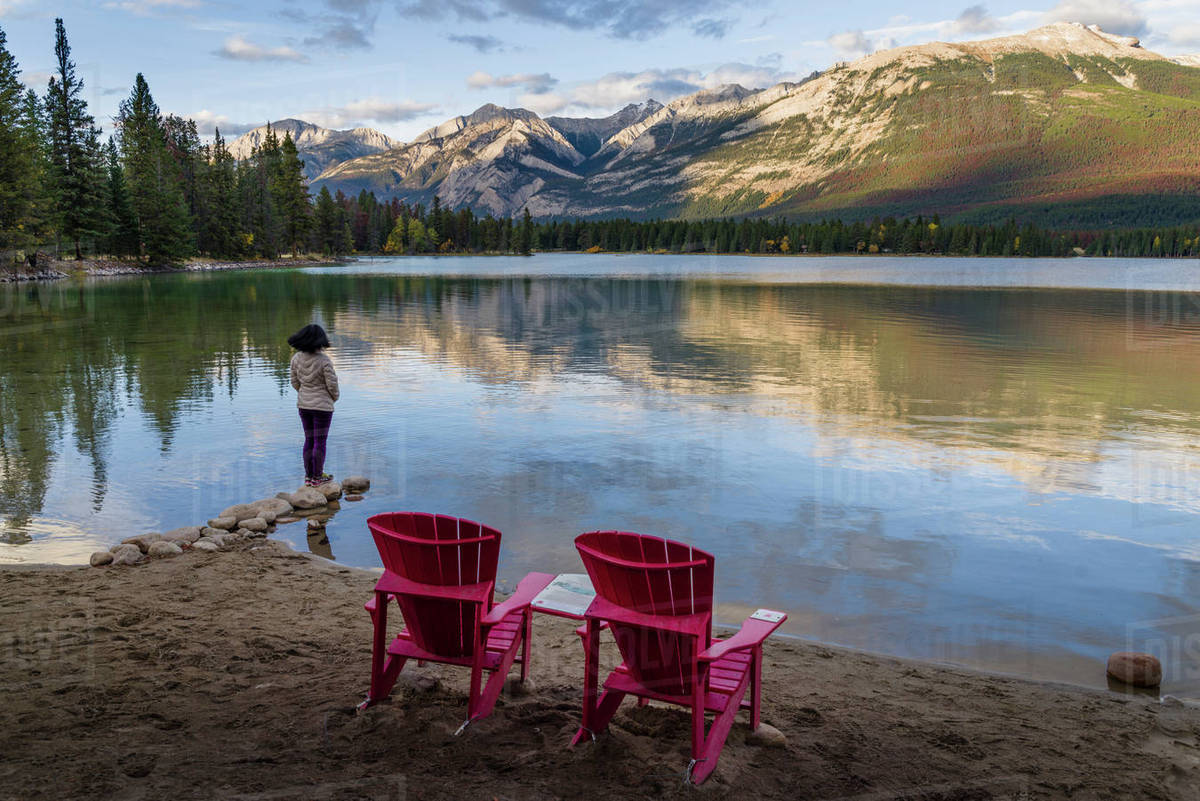 tourist and red chairs by lake edith jasper national park unesco