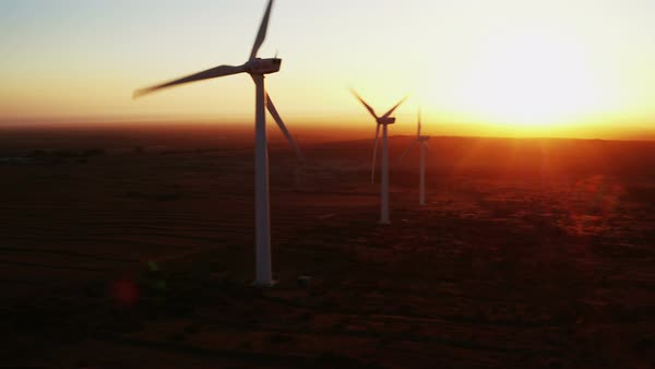 Aerial view of large wind turbines in a wind farm in California, USA, at sunset, producing sustainable and renewable energy. Royalty-free stock video